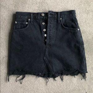 A gold E quinn Jean skirt
